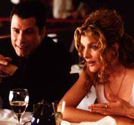 John Travolta as Chili Palmer and Rene Russo as Karen Flores on Get Shorty